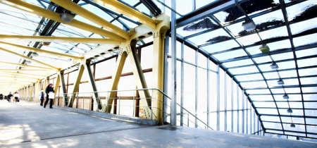 Yellow metal corridor with windows, crowd mooving Stock Photo - 3846600