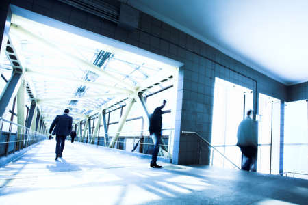 Blue corridor, people mooving near staircase photo