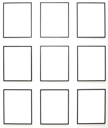 proto: Nine empty frames on white wall exhibition in Museum Stock Photo