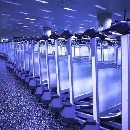 Luggage carts at nternational airport photo