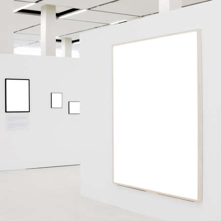 gallerie: Big empty frame on white wall exhibition and some small Stock Photo