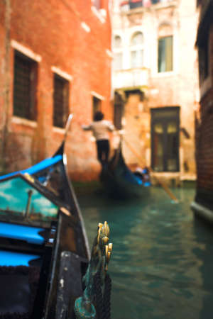 Gondola nose on water, Venice channel, Italy photo
