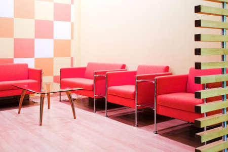 elbowchair: Red chairs and table in waiting room