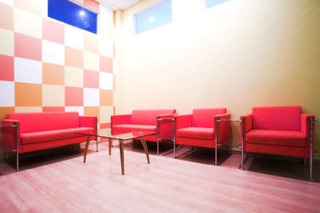 vip area: Red chairs and table in waiting room