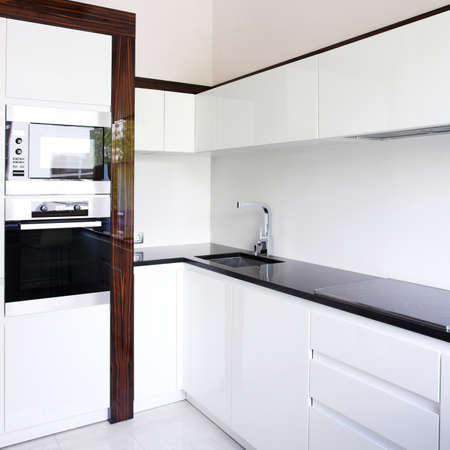 Kitchen interior corner in white photo