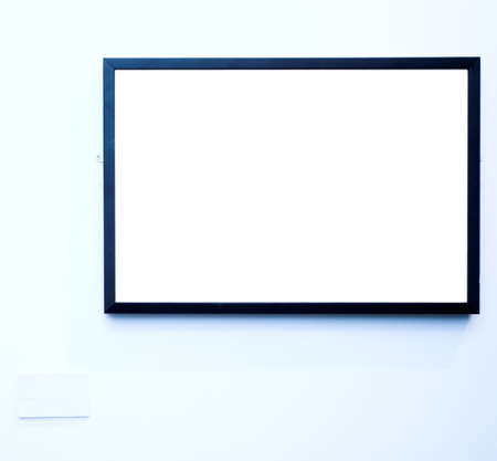 empty frame on blue wall in museum photo