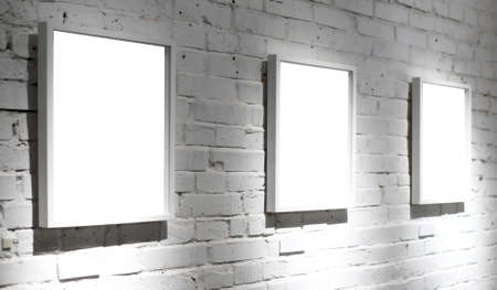 Three frames on white wall in museum Stock Photo