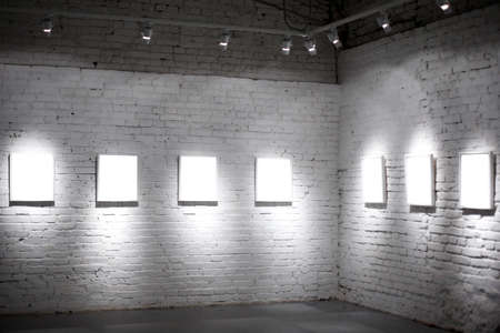 Seven white empty frames on exposition Stock Photo