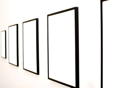 Five empty frames on white wall exhibition in Museum photo