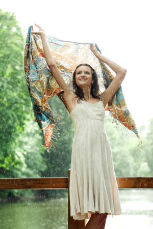Girl stay under rain drops cover shawl photo