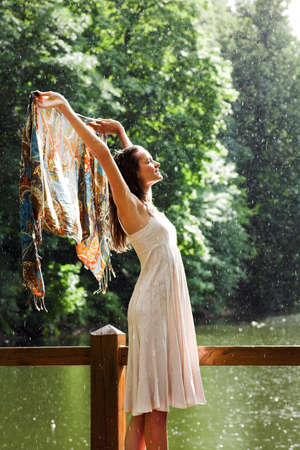 rainy season: Girl stay under rain drops cover shawl