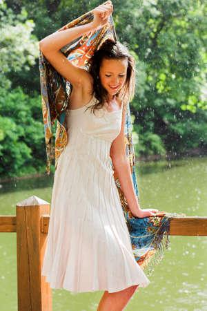 Girl stay under rain drops cover shawl Stock Photo - 4305730
