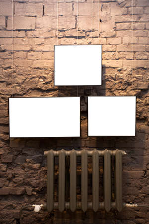 proto: Three empty frames on brick wall in museum