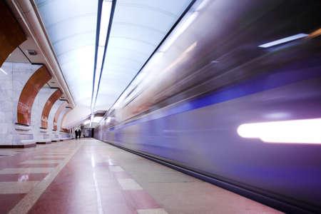 Moving train on underground station photo