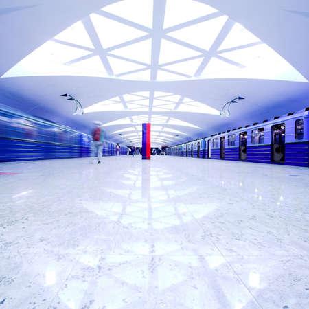 Two trains on underground platform photo