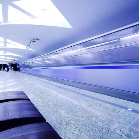 Bench and train on underground platform photo