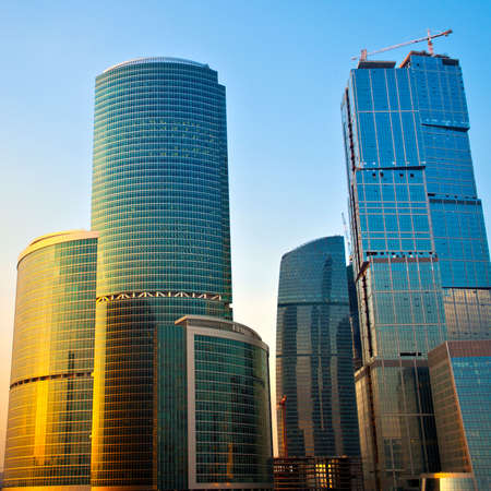 New skyscrapers business centre at evening, gold reflections Stock Photo - 4478572
