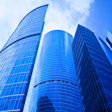 erect: Blue skyscrapers heads in business centre Stock Photo