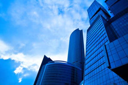 erect: Dark blue skyscrapers in business centre
