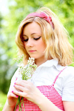 Blonde beautiful girl portrait with white flowers photo