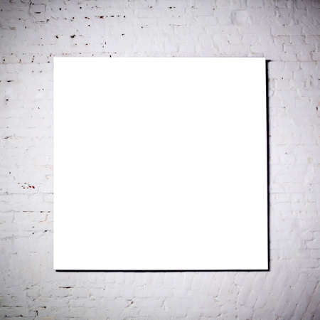 White frame on  white brick wall in museum