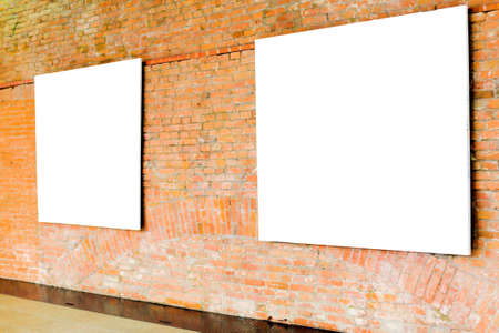proto: Two frames on brick wall in museum Stock Photo