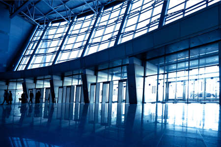 exhibition hall: People in wide blue hall window in exposition center, left copmosition Stock Photo