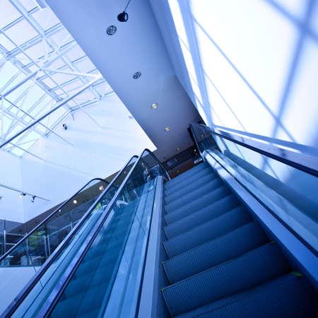 Escalator in blue corridor in office centre photo