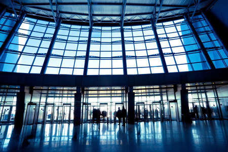 business exhibition: People in wide blue hall window in exposition center
