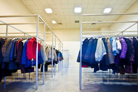 checkroom: Many clothes in cloakroom