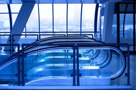 Escalator enter in violet corridor in office centre photo