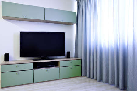 Corner in modern room with TV and bookcases Stock Photo - 4762723