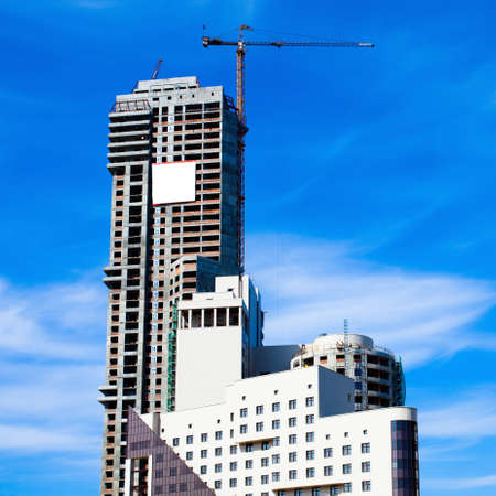 Crane and modern unfinished highrise house photo
