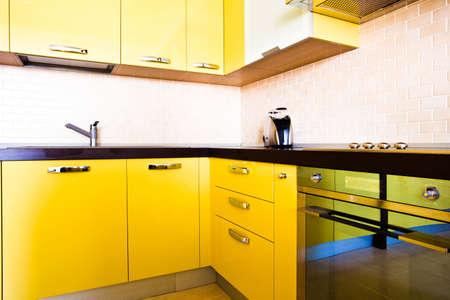 Yellow kitchen interior in modern flat Stock Photo - 4805841