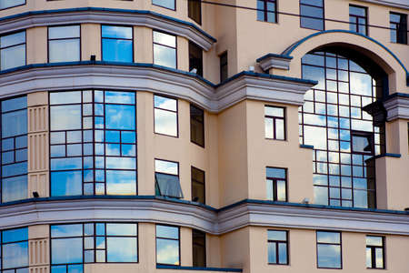 facade of modern building with reflection of blue sky Stock Photo - 4805844