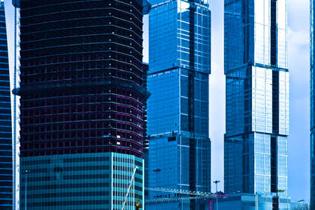 Three skyscrapers constructions with cranes in Moscow, Russia photo