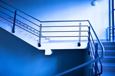 Empty stairs in office in blue photo