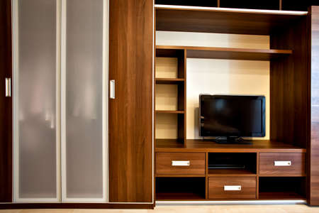 modern bookcase and wardrobe with TV-sistem photo
