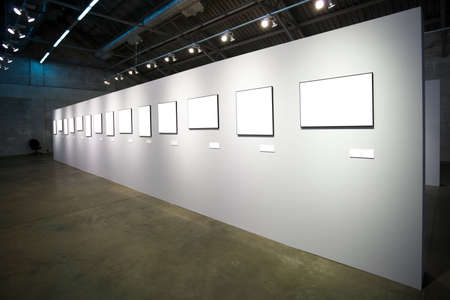 white wall with many empty frames photo