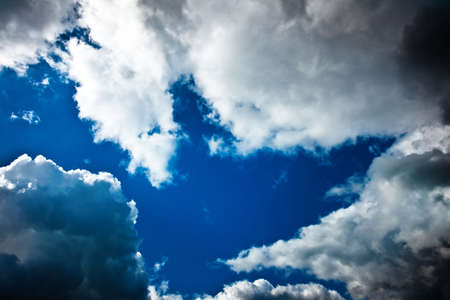 dark blue cloudly sky with ray of sunlight after storm photo