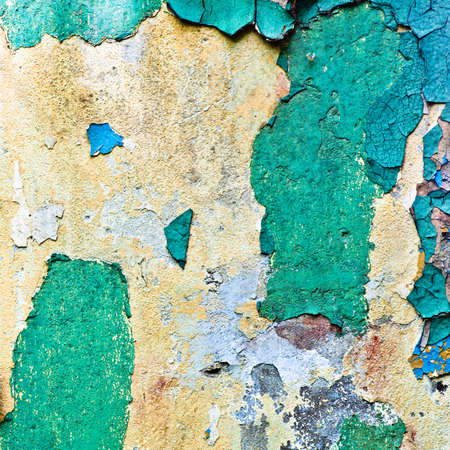 crop of old multicolours wall (azure, brown, blue) photo