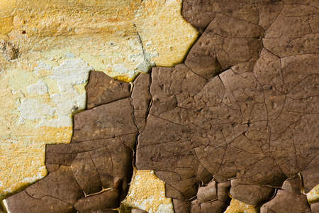 crop of old multicolours wall (yellow, white, brown) photo