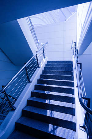 Empty staircase in office in blue photo