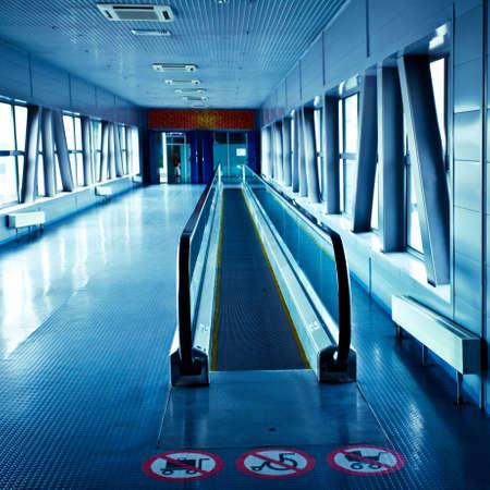 Empty blue escalator view in corridor in modern office centre photo
