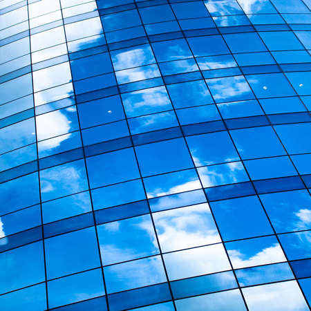 Abstract crop of modern office skyscraper with ski'es reflection Stock Photo - 5192213