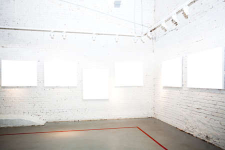 Brick white walls in museum with empty frames