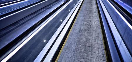 Empty blue moving escalator in Barcelonas subway photo