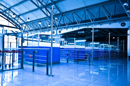 Passport control�s cabines in airport in blue photo