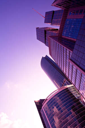 New skyscrapers at evening light,  violet sunshine photo