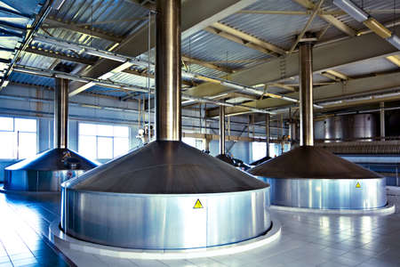 On the territory of brewers plant with steel fermentation vats photo